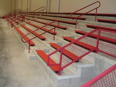 red bleachers on concrete foundation