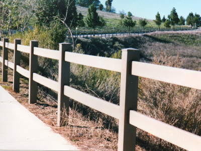 2-Rail fence along sidewalk in more rural setting